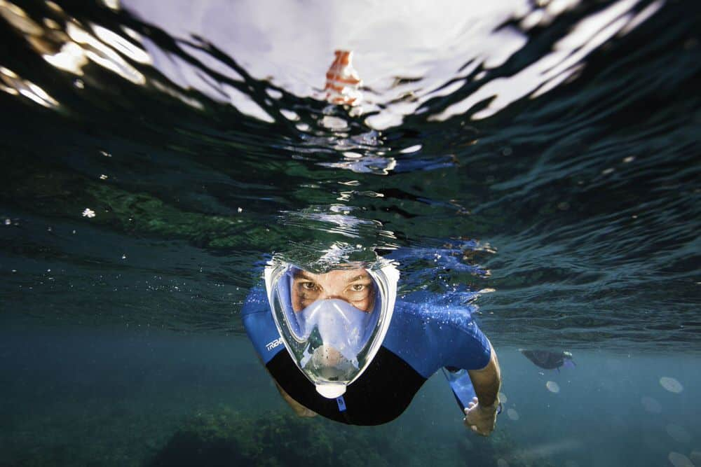 man underwater with full face snorkeling mask