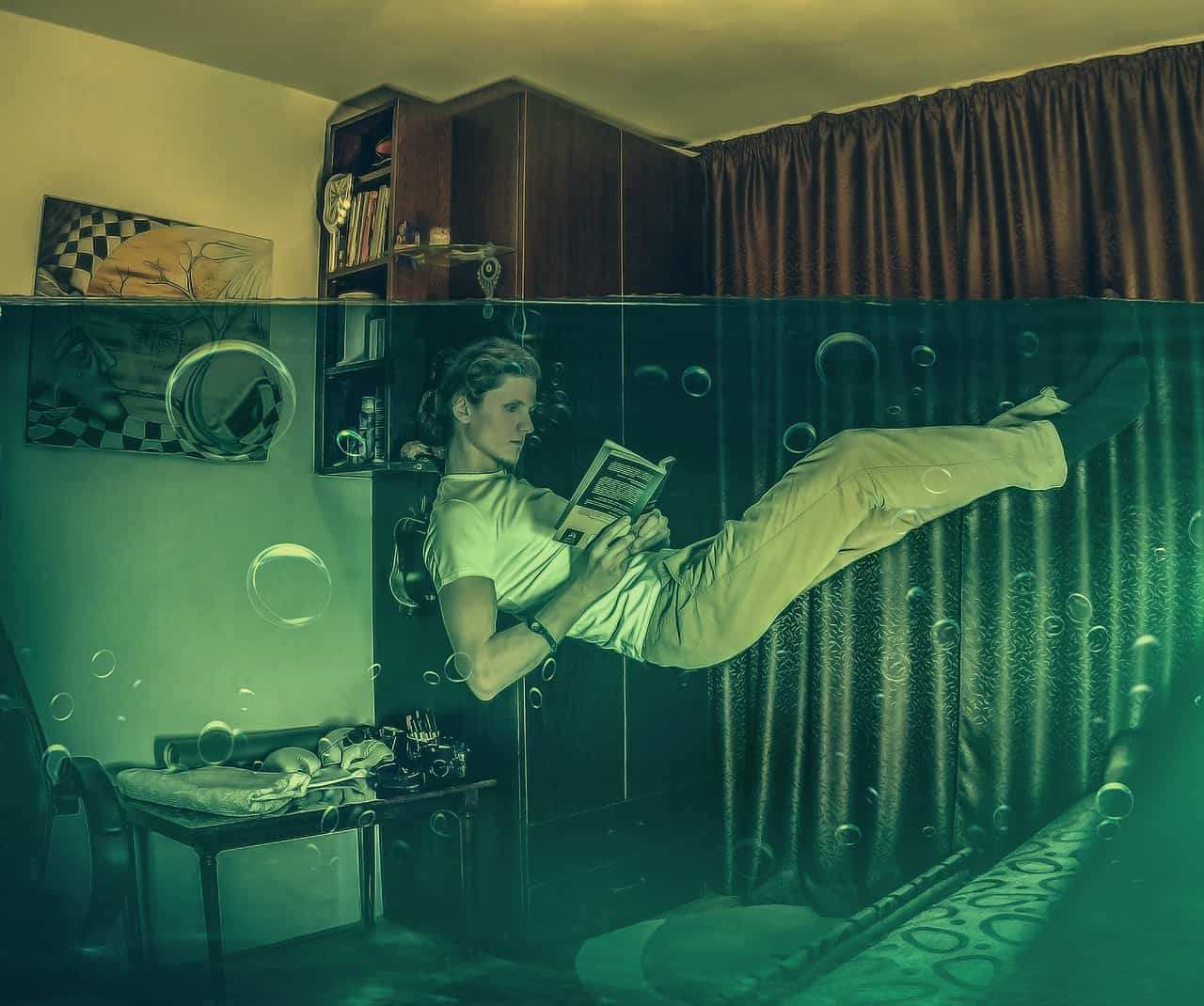 man floating in water in a room